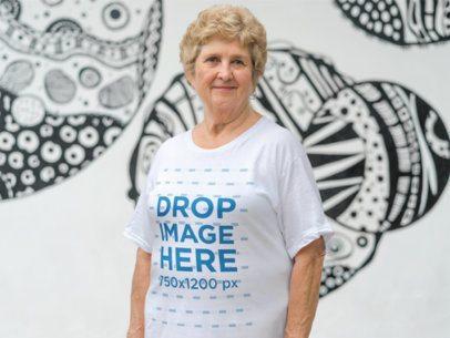 Senior White Woman Wearing a T-Shirt in an Urban Space a10937