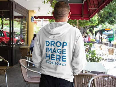 Back of a Man Wearing a Zip Up Hoodie Mockup at a Coffee Shop a10855b
