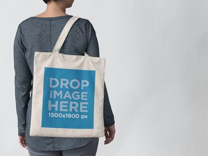Tote Bag Mockup Carried on a Woman's Shoulder a11437