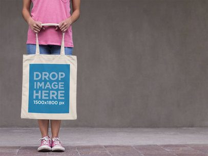 Tote Bag Mockup Carried by a Young Woman in the Street a11449
