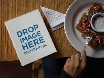 Paperback Book Mockup at Breakfast a12031