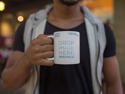 Young Man Holding a Coffee Mug Mockup a12299