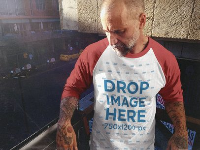 Raglan T-Shirt Mockup of a White Middle Aged Man Standing in a City Balcony a12614