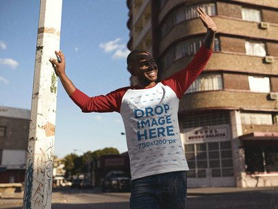 Smiling Young Black Man Looking at the Sun in his Raglan T-Shirt Mockup a12546