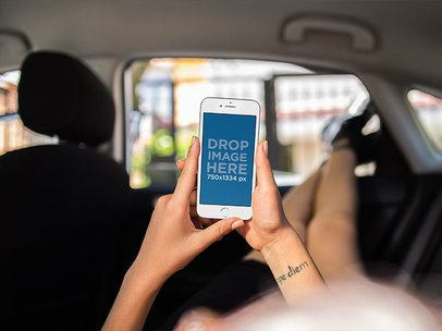 White iPhone Mockup Held in Portrait Position by a Girl Lying in the Backseat of a Car a12963standard
