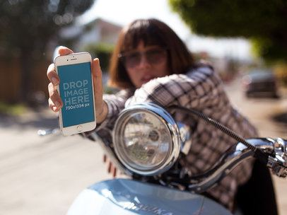 iPhone Mockup in Portrait Position Featuring a Woman in a Vintage Scooter Outdoors 12955