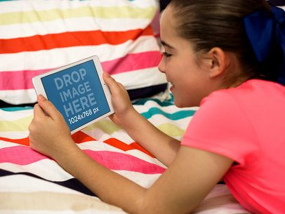 Little Girl Playing with her iPad Mini in her Bedroom Mockup a12997