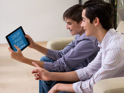 iPad Mini Mockup Featuring Two Young Boys Playing in Their Living Room a13061