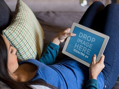 Mockup of a Woman Chilling on a Couch Staring at an iPad in Landscape Position 13098s