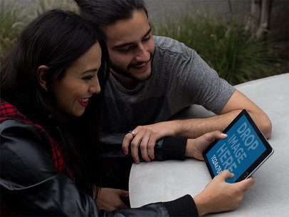 Young Couple Using a Black iPad in Landscape Position at their Terrace a13115
