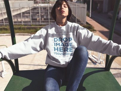 Crewneck Mockup of a Beautiful Girl with Short Hair Sitting with Her Eyes Closed in the Sun a12656