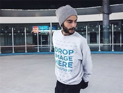 Young Man Wearing a Beanie and Crewneck Mockup While Skating a13253
