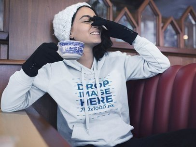 Young Woman Laughing in a Diner Pullover Hoodie Mockup a13182