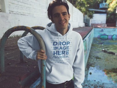 Skater Guy Wearing a Pullover Hoodie Mockup at a Pool a12843