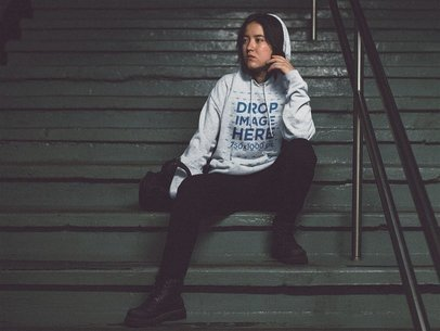 Hoodie Mockup of a Cool Asian Girl Sitting on some Stairs at Night a12696