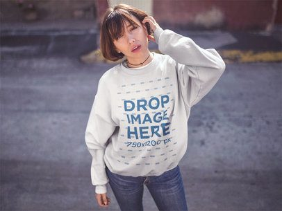 Trendy Short Haired Girl Standing in a Street Wearing a Crewneck Sweatshirt Mockup a12673