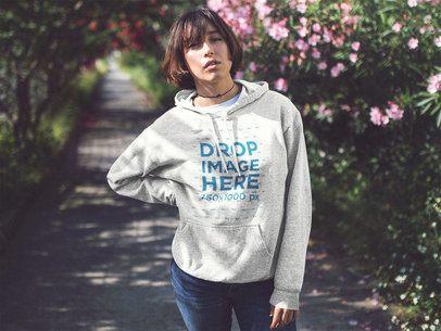 Pullover Hoodie Mockup of an Asian Girl Near a Flower Garden a12681