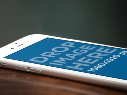 White Angled iPhone Close Up Mockup Over a Wooden Surface a12702