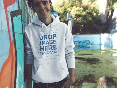 Young Man Wearing a Pullover Hoodie in an Abandoned Pool Mockup a12837