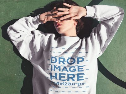 Short Haired Girl Lying in the Sun Wearing a Crewneck Sweatshirt Mockup a12669
