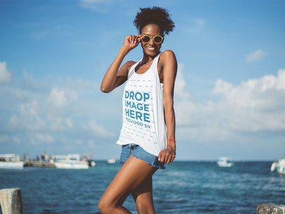 Tank Top Mockup Featuring a Smiling Young Woman at the Beach a12739