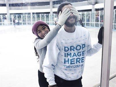 Young Couple Playing at a Skating Rink Wearing a Crewneck Mockup b13257