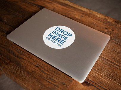 Sticker on a Closed MacBook Over a Wooden Surface Template a14334