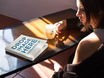 Book Mockup of a Girl Sitting Down While a Ray of Light Sneaks In a14273
