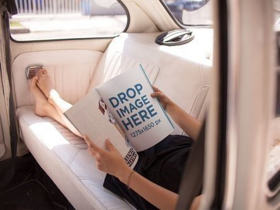 Mockup of a Young Woman Reading a Magazine While Relaxing in the Back of a Car a14392