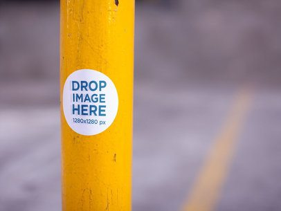 Round Sticker on a Yellow Pole in a Parking Lot Mockup a14345