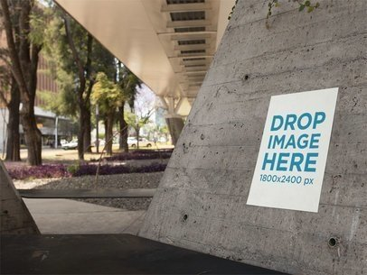 Poster on a Concrete Structure Below a Bridge in the City Mockup a14473