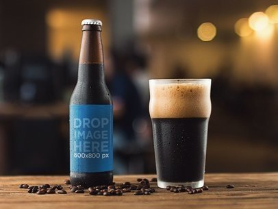 Mockup of a Stout Beer Bottle With a Glass Besides It a14614