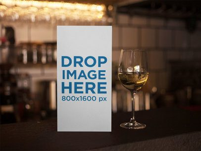 Standing Menu Template Inside a Bar With a Glass of White Wine Beside it a14766