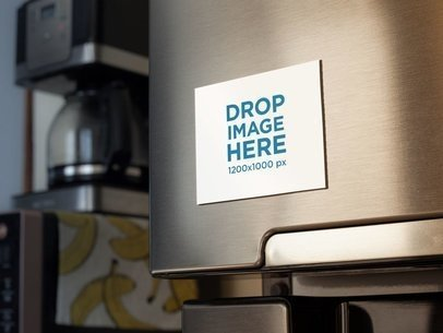 Fridge Magnet Mockup With a Coffee Machine and Bananas Print in the Back a14789