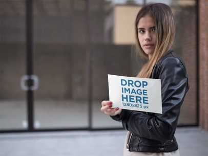 Template of a Girl Holding a Flyer While Walking in the City a14803
