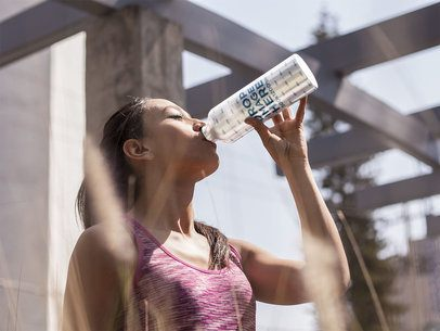 Young Woman Drinking Water from an Aluminum Bottle Template a14878