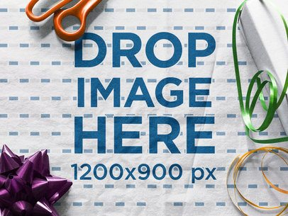 Wrapping Paper Mockup with Scissors and Gift Items Above a14961