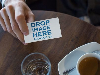 Man Showing a Business Card Template While at the Cafe a15005
