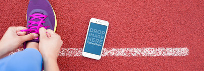 Beautiful iPhone 6 Mockup Template at a Running Track a4245