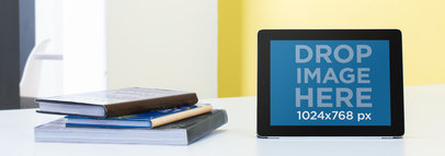 Mockup Template of an iPad Standing on a Table in a Classroom a9481